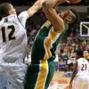 Brad Davis/Register-Herald<br /> Greenbrier East's Ty Walker drives to the basket against Huntington's Dajon Congleton Thursday night.