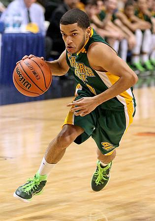 Brad Davis/The Register-Herald<br /> Greenbrier East's Christian Ortiz drives to the basket Thursday night at the Charleston Civic Center.