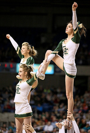 Brad Davis/The Register-Herald<br /> Greenbrier East cheerleaders perform during a break in the Spartans' game against Huntington Thursday night at the Charleston Civic Center.