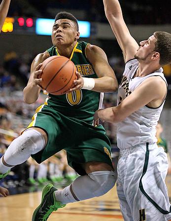 Brad Davis/The Register-Herald<br /> Greenbrier East's Ty Walker drives and scores against Huntington's Charles Mann Thursday night at the Charleston Civic Center.