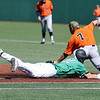 Brad Davis/The Register-Herald<br /> Marshall catcher Matt Reed dives into first base to make it safely against UTSA March 15 at Linda K. Epling Stadium.