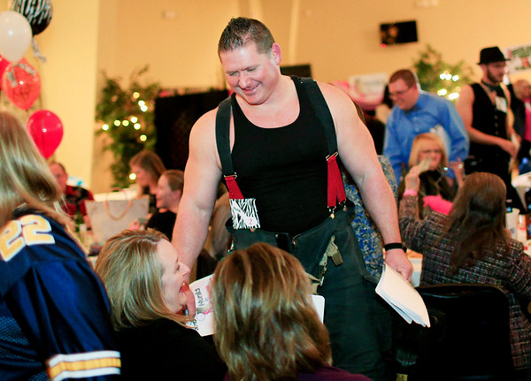 Chris Jackson/The Register-Herald<br /> Rick Fisher, who won the 2015 Hottest Hunk, speaks with members of the audience during the second annual BNI Hunks In Heels at the Beckley Moose Lodge on Friday.