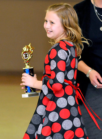 Brad Davis/The Register-Herald<br /> 10-year-old Olivia Ross, a 4th grader at Glenwood School in Mercer County, takes first place in the economics category during the awards portion of the Regional Education Service Agencies (RESA) Regional Social Studies Fair Saturday afternoon at the Beckley-Raleigh County Convention Center.