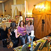 Brad Davis/The Register-Herald<br /> Fayetteville resident and bride-to-be Tiffany Calvert (below in purple) chats with an associate from Mia Bella Originals Interior Design and Event Planning with her mother Debbie during the Beckley Bridal, Prom and Special Occasions Fair Saturday afternoon at Tamarack.