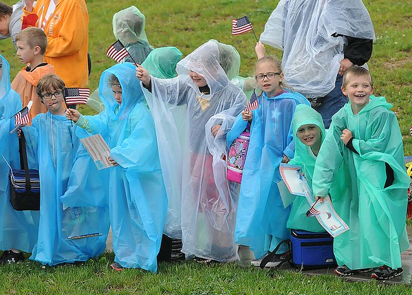 Rick Barbero/The Register-Herald<br /> Students at Rainelle Elementary School wave flags to over 500 bikers that paraded through the town of Rainelle Thursday afternoon as they make their Run for the Wall to Washington, DC