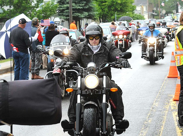 Rick Barbero/The Register-Herald<br /> Over 500 bikers parade through the town of Rainelle Thursday afternoon as they make their Run for the Wall to Washington, DC.