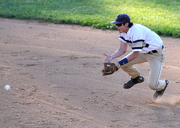 Brad Davis/The Register-Herald<br /> Greenbrier West second baseman Justin Harless fields a ground ball during the Cavaliers' and Crusaders' suspended sectional game Wednesday night in Beckley.