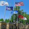 Brad Davis/The Register-Herald<br /> The American flag is raised last among the various service flags representing (from left) the U.S. Army, Navy, Air Force, Marines, Coast Guard and Prisoners of War/Missing in Action during a Memorial Day ceremony at the Restwood Cemetery in Summers County Monday morning.