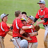 Brad Davis/The Register-Herald<br /> Greater Beckley Christian players mob one another in celebration after the Crusaders defeated the Greenbrier West Cavaliers in a close game three to advance in sectional play Saturday afternoon in Beckley.