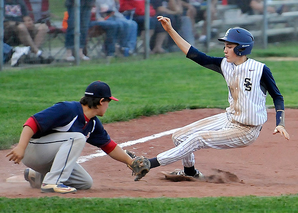 Brad Davis/The Register-Herald<br /> Shady Spring's Caleb Lilly manages to evade the tag from Independence third baseman Nick Lester to make it in safely during the 5th inning of the Tigers' 4-3 win over the Patriots Wednesday evening in Shady Spring.