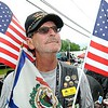 Rick Barbero/The Register-Herald<br /> Steve Strout, American Legion Post 32 Rider, of Springfield Illinois, just finished up riding his bike through the town of Rainelle Thursday afternoon as he makes a Run for the Wall to Washington, DC.