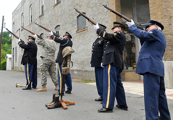 Brad Davis/The Register-Herald<br /> Members of the Fayetteville's American Legion Post 149 Military Honor Guard fire their weapons into the air during a re-dedication ceremony for Mt. Hope's World War I memorial along Main Street Saturday afternoon.