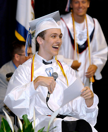 """Brad Davis/The Register-Herald<br /> Independence senior and student body president Chase Williams ad libs his way through a hilarious """"changing of the tassel"""" speech during the school's 39th commencement ceremony Saturday morning at the Beckley-Raleigh County Convention Center."""
