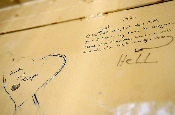 Brad Davis/The Register-Herald<br /> The former Fayette County Jail, which now serves as a museum, only ceased holding inmates in 1994, meaning etchings, messages, names and dates can still be found all over the place in the old facility, many from not too long ago.