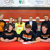 Brad Davis/The Register-Herald<br /> Greater Beckley Christian School athlete Brent Daniels finishes up signing his letter of intent to join the basketball program at West Virginia Weslyan surrounded by his parents Michelle and Donnie (directly beside Brent), his grandparents Bruce (3rd from right, back row) and Carol Billups (far left), his uncle Scott Nestor (2nd from left), his coach Brian Helton (2nd from right) and a handful of friends and family Friday afternoon in Prosperity.