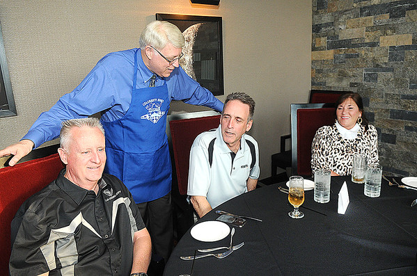 Rick Barbero/The Register-Herald<br /> Beckley Mayor Bill O'Brien, standing talks with Buster Jones, left, of Crab Orchard, Chuck and Nancy Farmer, of Beckley, during Celebrity Night Monday at Black Knight Country Club.