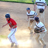 Brad Davis/The Register-Herald<br /> Greater Beckley's Wil Mullins gets caught in a rundown between first and second base before managing to escape and ending up safe at second during the Cavaliers' and Crusaders' suspended sectional game Wednesday night in Beckley.