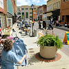 Brad Davis/The Register-Herald<br /> Shoppers browse the street at the Neville Street Market Saturday morning.