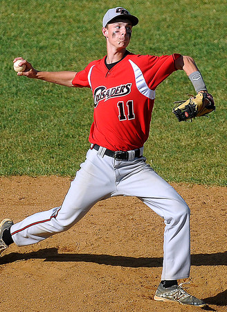 Brad Davis/The Register-Herald<br /> Greater Beckley starting pitcher Brett Green delivers during the Crusaders' win over Greenbrier West Friday evening in Beckley.