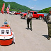 Brad Davis/The Register-Herald<br /> Travis Daugherty (left) of the Army Corps of Engineers and the National Park Service's Richard Altare patrol the boatlaunch area of Bluestone Lake with Corey the Corps Boat looking for people they can catch being safe on the water by wearing life jackets Saturday afternoon.