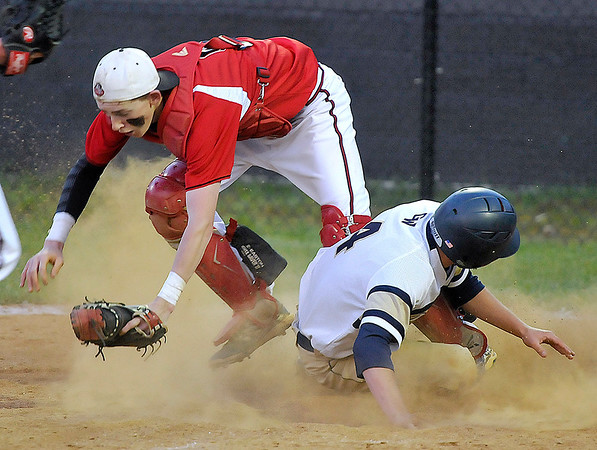 Brad Davis/The Register-Herald<br /> Greenbrier West's Dustin Yaokum slides hard into home with bases loaded, but not before Greater Beckley's Brett Riffe made the catch to put him out on a force during the Cavaliers' and Crusaders' suspended sectional game Wednesday night in Beckley.