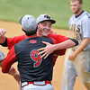 Brad Davis/The Register-Herald<br /> Greater Beckley Christian's Jake Bishop embraces one of his coaches in celebration as Greenbrier West senior Chandler Fitzwater (background right) exits the field for the last time in his career following the Crusaders' game three sectional win over the Cavaliers Saturday afternoon in Beckley.