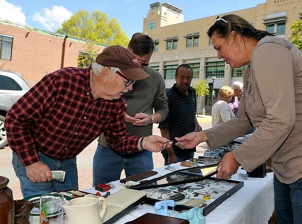 Brad Davis/The Register-Herald<br /> Glen Morgan resident Richard Spooner, left, browses some antique items available at vendor Kim Muncy's (far right) table Saturday morning in uptown Beckley.