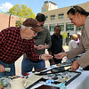 Brad Davis/The Register-Herald<br /> Glen Morgan resident Richard Spooner, left, browses some antique items available at vendor Kim Muncy's (far right) table Saturday morning in uptown Beckley.