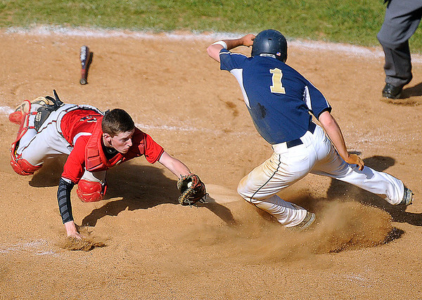 Brad Davis/The Register-Herald<br /> Greater Beckley catcher Brett Riffe, left, makes the tag on Greenbrier West baserunner Chris Patton during the third inning of the Crusaders' win over the Cavaliers Friday evening in Beckley.