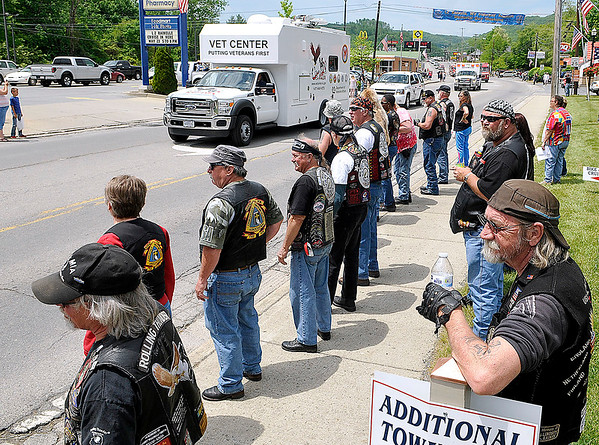 Brad Davis/The Register-Herald<br /> Visiting veterans and area residents watch along Greenbrier Avenue as the LZ Rainelle Veterans REunion and Memorial Day parade makes its way through the town Saturday afternoon.