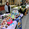 Brad Davis/The Register-Herald<br /> Vendors Julie Green, left, and Kathy Greives take in a beautiful day at their tables Saturday morning at the Neville Street Market.