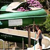 Rick Barbero/The Register-Herald<br /> Kristin Duguid, lifeguard at New River Park pool, skims debris out of the waterslide preparing it for the summer season.