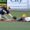 Brad Davis/The Register-Herald<br /> Richmond's #32 reaches out to make a tag as West Virginia's Marcus McCorkle dives for second on  an attempted steal Saturday night at Linda K. Epling Stadium.