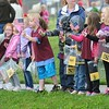 Rick Barbero/The Register-Herald<br /> Students at Rainelle Elementary School wave flags to over 500 bikers paraded through the town of Rainelle Thursday afternoon as they make their Run for the Wall to Washington, DC