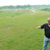 Rick Barbero/The Register-Herald<br /> James Allen, executive director Raleigh County Solid Waste Authority, points to an area where a proposed dog park will be developed.
