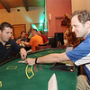 Chris Jackson/The Register-Herald<br /> Chas Cappellari, right, with Computer One, and Matt Durnan, with United Bank, at the blackjack table setup at Fujiyama on Harper Rd. in Beckley during Celebrity Night  on Monday, May 4, 2015.