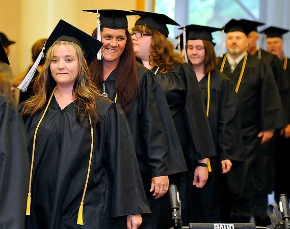 Brad Davis/The Register-Herald<br /> Graduates make their way to their seats during the opening moments of Valley College's Spring commencement Friday evening in the Tamarack Conference Center.