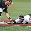 Brad Davis/The Register-Herald<br /> Concord first baseman Ryan Johnston applies the tag and picks off West Virginia State's Brandon Wright during the Mountain Lions win over the Yellow Jackets Thursday afternoon in Mountain East Conference Tournament play.