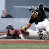 Brad Davis/The Register-Herald<br /> Concord's Jerrod Groves is tagged out at home plate by West Virginia State catcher Tyler Payne after Groves blew through the third base coach's stop sign during the Mountain Lions' Mountain East Conference Tournament loss to the Yellow Jackets Saturday night at Linda K. Epling Stadium.