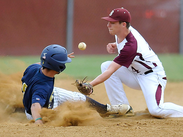 Brad Davis/The Register-Herald<br /> Shady Spring's John Lively steals second base as the throw hits him before Woodrow Wilson second baseman Brandon Chandler can snag it Saturday afternoon.
