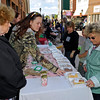 Brad Davis/The Register-Herald<br /> Just Like Grandma's Baked Goods owners Jane Meadows, left, and Elizabeth Meadows assist customers as they browse their items at the Neville Street Market Saturday morning.