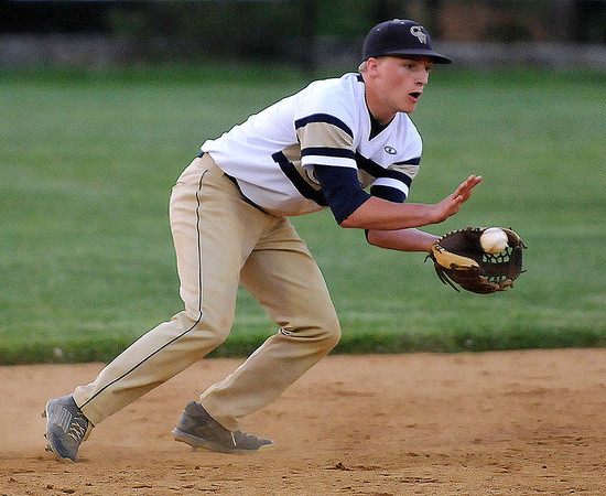 Brad Davis/The Register-Herald<br /> Greenbrier West shortstop Dustin Yaokum fields a ground ball during the Cavaliers' and Crusaders' suspended sectional game Wednesday night in Beckley.