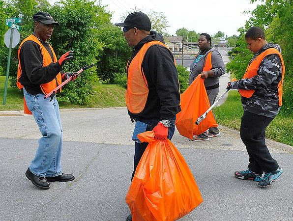 Brad Davis/The Register-Herald<br /> Volunteers participate in Heart of God Ministries' East Beckley cleanup effort Saturday morning.