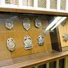 Brad Davis/The Register-Herald<br /> Different law enforcement officers' badges from past generations are among the many historic items housed in the museum.