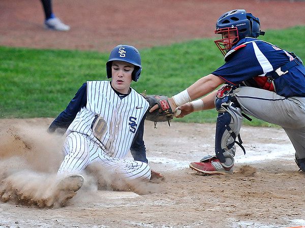 Brad Davis/The Register-Herald<br /> Shady Spring's Caleb Lilly slides across home plate before Independence catcher Ryan Brandstetter can apply the tag during the 5th inning of the Tigers' 4-3 win over the Patriots Wednesday evening in Shady Spring.