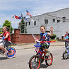 Brad Davis/The Register-Herald<br /> Area youngsters on decorated bikes make their way past Veterans Memorial Park along Rt. 60 Saturday afternoon as they participate in the LZ Rainelle Veterans REunion and Memorial Day parade.