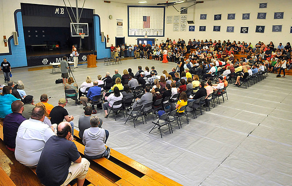 Brad Davis/The Register-Herald<br /> Hundreds of Meadow Bridge and Fayette County residents packed the gym at Meadow Bridge High School to voice their opinions and ask questions during a community meeting on the upcoming bond call and potential consolidation Thursday night.