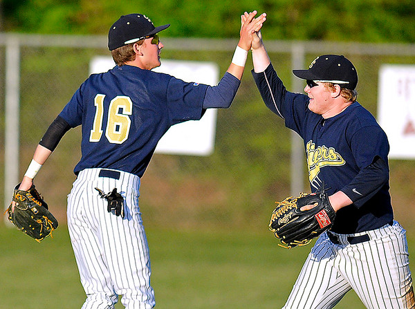 Brad Davis/The Register-Herald<br /> Shady Spring center fielder Michael Guilliams, left, gets a high five from teammate Brandon Thompson after catching the final out to defeat Oak Hill in sectional play Friday evening at Woodrow Wilson High School.