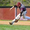 Brad Davis/The Register-Herald<br /> Woodrow Wilson shortstop Michael Maiolo makes a running play on a ground ball against Greenbrier East May 8.