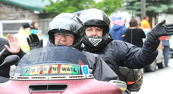 Rick Barbero/The Register-Herald<br /> Couple bikers parade through the town of Rainelle Thursday afternoon as they make their Run for the Wall to Washington, DC.